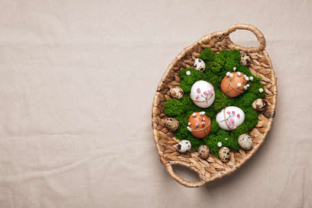 Easter eggs with natural flowers decor on linen tablecloth. Zero Waste Easter, copy space