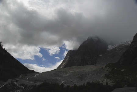 nebbia: The white mountain in the Alps seen from the Italian side