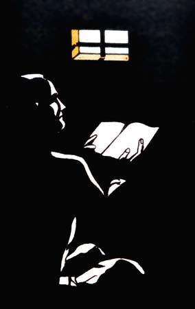 recollection: A man reading a book in the twilight of a cell, a prisoner or recollection,