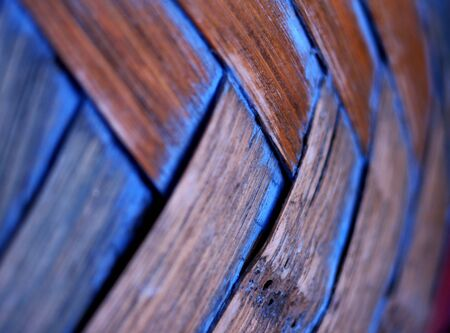 criss: Textures of blue and brown woven together in a criss cross pattern. Stock Photo