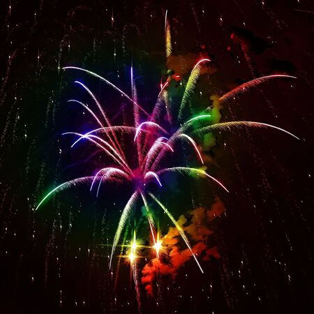 A digital alteration of some fourth of july fireworks in the evening sky. photo