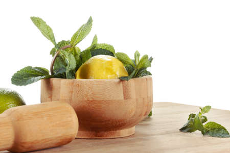 Lemon and mint on white background