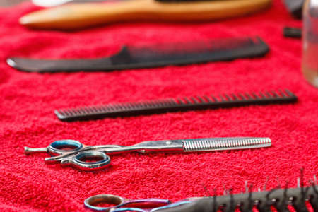 Hairdresser tools on black background with copy space in center Zdjęcie Seryjne