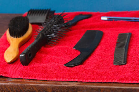 Tools for cutting hair and shaving on a red background