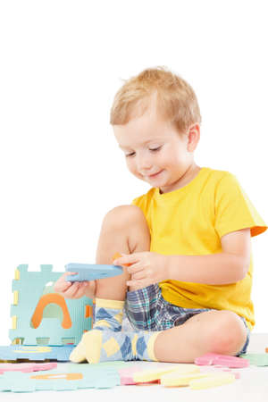 Letters puzzles. Learning the alphabet. Baby on a white background.