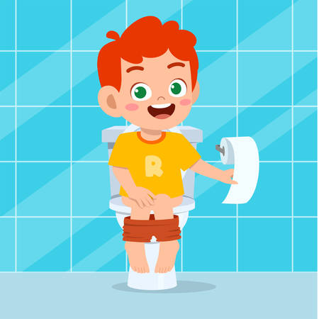 happy cute kid boy sit on the toilet