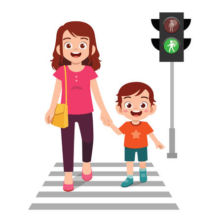 happy cute little kid boy cross the road with mother