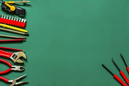 A set of tools for building and repair on green background Stock Photo