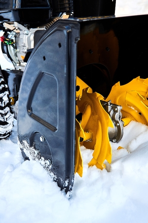 Close-up of the snowthrower ready for cleaning the snow in the winter after a snowstorm Standard-Bild