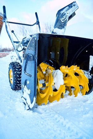 Close-up of the snowthrower ready for cleaning the snow in the winter after a snowstorm Stock Photo