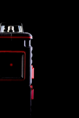 Modern laser level and special glasses are on the table on a black background. Can be used as a background image. 스톡 콘텐츠