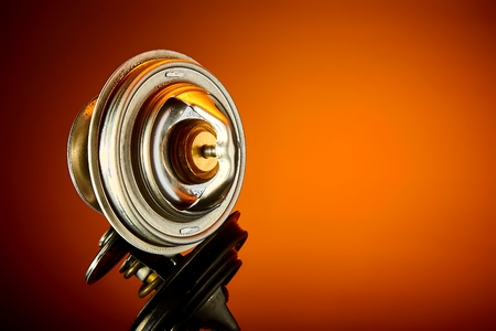 thermostat for engine cooling system of the car is wet to a dark glass
