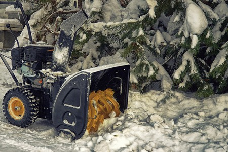 A snow thrower is the best assistant for snow removal in the winter Imagens