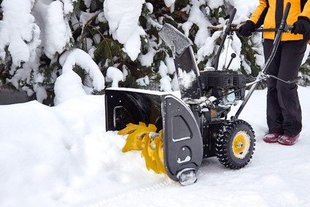 A snow thrower is the best assistant for snow removal in the winter Reklamní fotografie