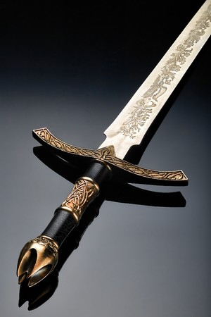 Ancient iron sword from the game photographed close-up on a dark background Imagens