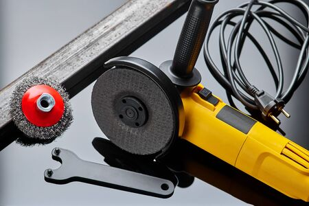 angle grinder for metal on dark background close-up