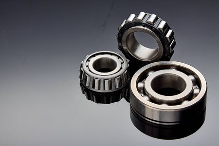 Close-up of a set of ball and roller bearings on a dark background