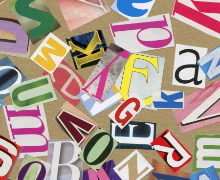 clippings: Handmade collage of newspaper, magazine alphabet clippings on paper background. Stock Photo