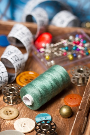 sewing box: Sewing thread and material for sewing in wooden box Stock Photo