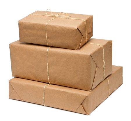 pack string: Stack of parcel wrapped in brown paper and tied with rough twine