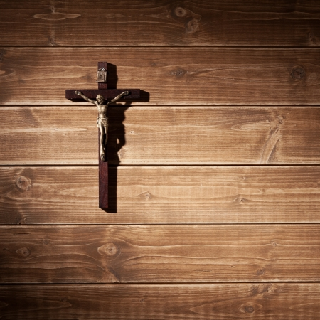 Suffering of Jesus Christ on the wooden wall in a spotlight. photo