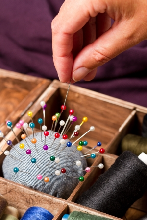 pinhead: Sewing pins in a hand