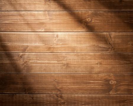 tabulka: Dřevěné zeď na pozadí v ranním světle. Se stíny z okenní rám. Reklamní fotografie