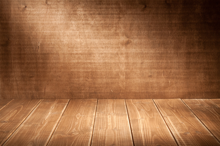 Wooden wall background with spotlight