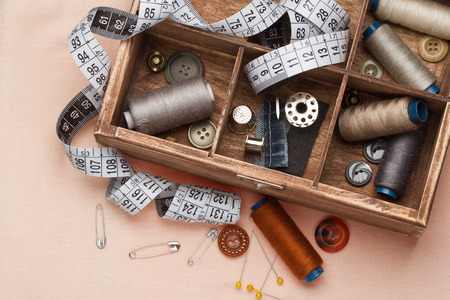 sewing box:  Sewing tools in a wooden box