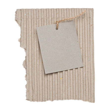 Cardboard with  paper tag isolated on white background photo