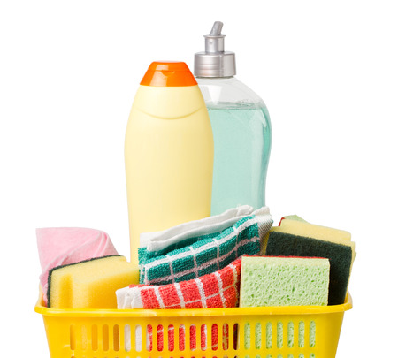 Powder cleanser, dish soap, duster and sponges in basket isolated on white Stock Photo