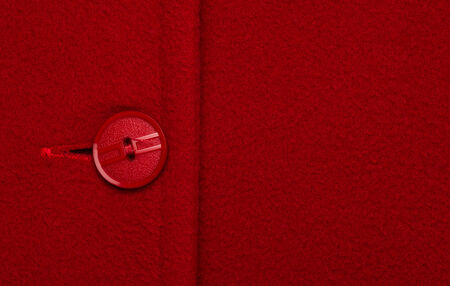 unattached: Button on red coat Stock Photo