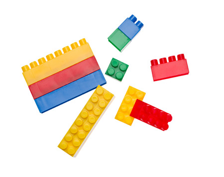 Colored toy bricks isolated on white photo