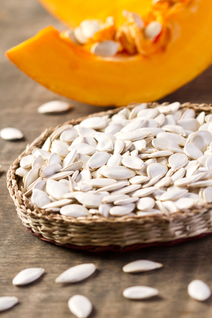 Pumpkin seeds in wicker mat  Stock Photo