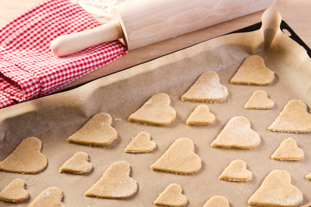 Heart shaped cookies in baking tin photo