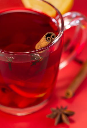 sooth: Fruit tea with spices and lemon in glass cup
