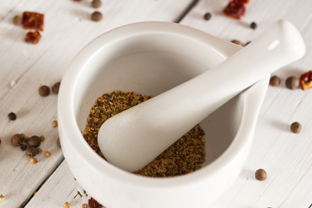 Ceramic Mortar with Pestle and fresh spices photo