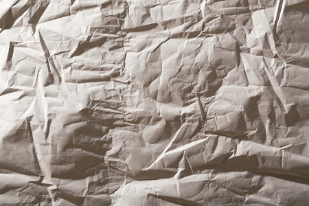 Crumpled paper texture. Recycled paper background photo