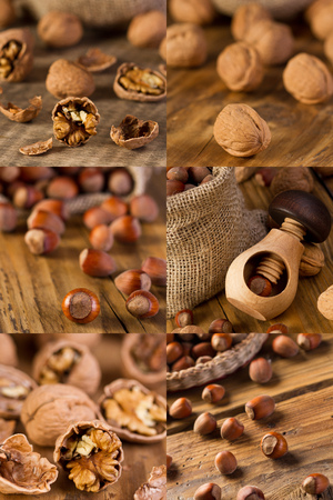Walnuts and hazelnuts  on old wooden table photo