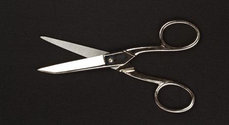 Metal scissors on black background Stock Photo