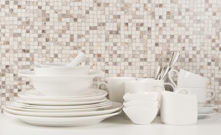 Kitchen crockery on white kitchen table Stock Photo