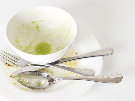 Dirty dishes on white kitchen table photo