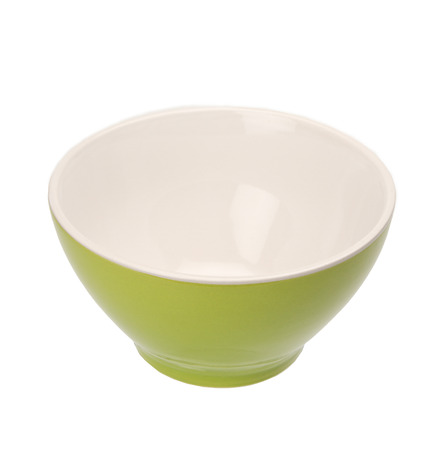 Green bowl isolated on white  photo