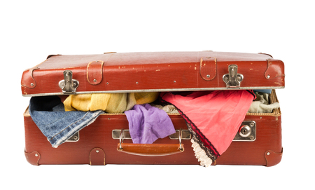 Clothes on old suitcase isolated on white Stock Photo