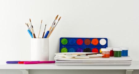 Drawing tools on white shelf photo