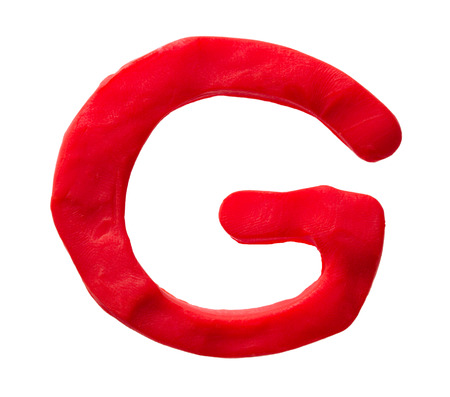 Plasticine letter G isolated on a white background Stock Photo
