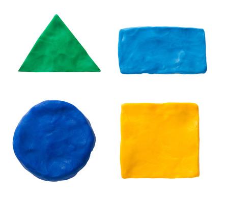 Plasticine  geometric shapes isolated on white