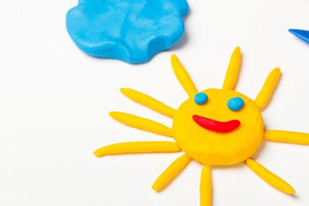 Plasticine sun with emoticons