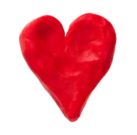 red heart: Red valentine heart made with plasticine. Isolated on white background
