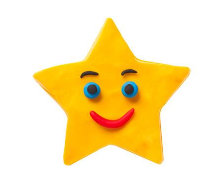 Smiling plasticine star isolated on white background Stock Photo